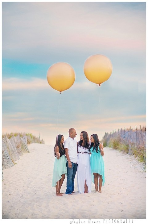 Family with whimsical balloons at Nickerson Beach