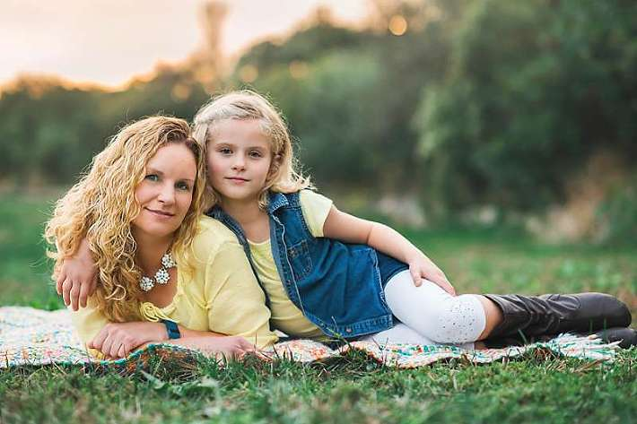 sweet mom and daughter pose