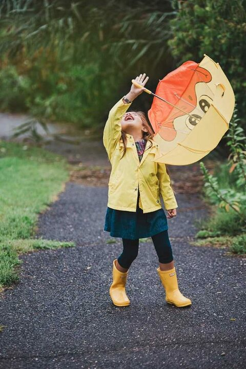 Long Island Child Photographer little girl playing in the rain