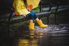 Long Island Child Photographer yellow boots on a cloudy day