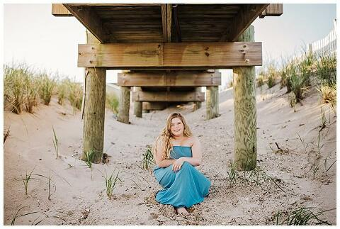 High school Senior Beach Session Long Island under the boardwalk